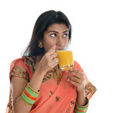 Indian woman drinking orange juice Royalty Free Stock Photos