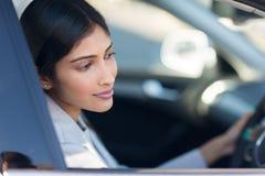 Indian woman driving car Royalty Free Stock Photos