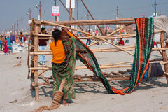Indian woman dry her sari outdoor Royalty Free Stock Photography