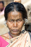 Indian woman with earrings and tatto face Stock Image