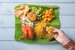 Indian woman eating biryani banana leaf rice Stock Photography
