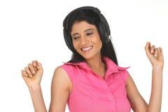 Indian woman enjoying music Royalty Free Stock Photos