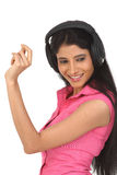 Indian woman enjoying music Royalty Free Stock Photography