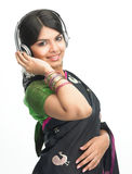 Indian woman enjoying music Stock Images