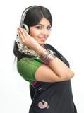 Indian woman enjoying music  happily Royalty Free Stock Photos