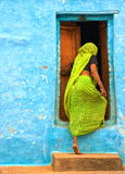 Indian woman entering the door Royalty Free Stock Photo