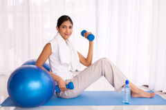 Indian woman exercising home Royalty Free Stock Image