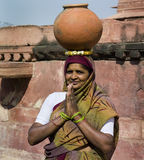 Indian woman - Fatehpur Sikri - India. Indian woman with pot balanced on her head at the Fatehpur Sikri citadel in Rajasthan in northern India Stock Photo