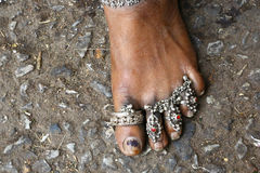 Indian woman foot adorned with silver jewels Stock Photo