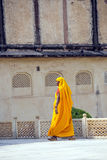 Indian Woman of the fourth Caste Shudras in traditional Sari. AMER, INDIA - 19 NOVEMBER: woman of fourth caste in brightly colored sari clean the Amber palace on Stock Image