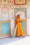Indian Woman of the fourth Caste wearing a traditional Sari. AMER, INDIA - 19 NOVEMBER: woman of fourt class in brightly colored sari clean the Amber palace on Stock Images