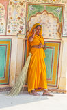 Indian Woman of the fourth Caste wearing a traditional Sari. AMER, INDIA - 19 NOVEMBER: woman of fourt class in brightly colored sari clean the Amber palace on Stock Photography