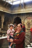 Indian woman with a girl standing inside of Karni Mata Temple, D Stock Photo