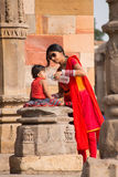 Indian woman giving water to her child at Quwwat-Ul-Islam mosque Stock Photography