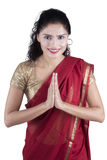 Indian woman with greeting gesture Royalty Free Stock Photography