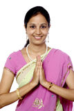 Indian woman greeting NAMASTE Royalty Free Stock Photography