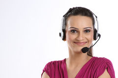 Indian woman with headphones Royalty Free Stock Photography