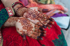An Indian woman with henna tattoos on the hands. India royalty free stock images