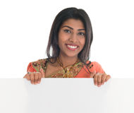 Indian woman holding blank billboard Royalty Free Stock Images