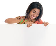 Indian woman holding blank card Royalty Free Stock Image