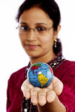 Indian woman holding a globe Stock Image
