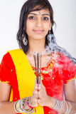 Indian woman holding incense Royalty Free Stock Photo