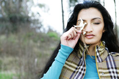 Indian woman holding necklace Royalty Free Stock Image