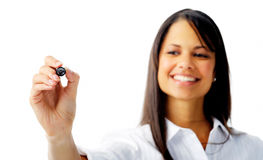 Indian woman holding out a marker pen Royalty Free Stock Image