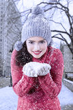 Indian woman holding snow with her hands Royalty Free Stock Photography