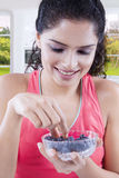Indian woman holds a bowl of blueberry Royalty Free Stock Image