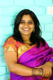 Indian Woman In Purple Saree Smiling Stock Photography