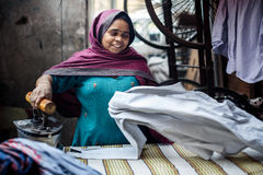 Indian woman ironing clothes in Delhi Stock Images
