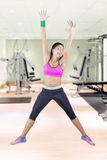 Indian woman jumping in the gym center Royalty Free Stock Photo