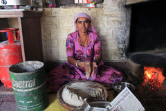 Indian woman in kitchen. Woman cooking chapati at the village in Nagaur district Stock Photos