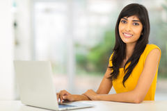 Indian woman laptop. Pretty indian woman using laptop at home Stock Images