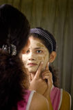 Indian woman looking in mirror Royalty Free Stock Images