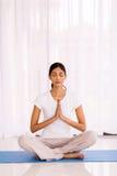 Indian woman meditating. Beautiful indian woman meditating in the morning Stock Photography