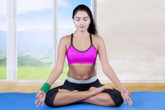 Indian woman meditating at home Stock Photos