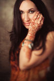 Indian woman with mehndi in traditional clothing Royalty Free Stock Photography
