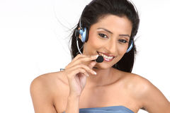 Indian woman with microphone Royalty Free Stock Photography