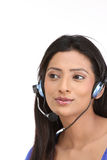 Indian woman with microphone Royalty Free Stock Image