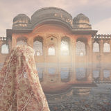Indian woman in the mist. Indian woman looking a palace in the mist Stock Image