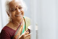 Indian woman with a mug Stock Image