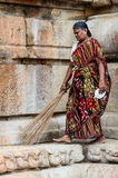Indian woman in national dress carries a broom Stock Photography