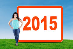 Indian woman with numbers 2015 on the meadow Royalty Free Stock Images
