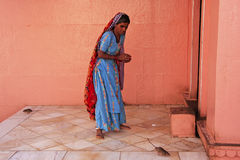 Indian woman offering food for rats, Karni Mata Temple, Deshnok, Royalty Free Stock Images