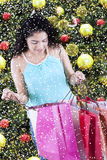 Indian woman opens christmas shopping bags Stock Photo