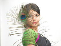 Indian woman with peacock feather Royalty Free Stock Photo