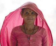 Indian woman in pink dress and shawl - India Stock Images