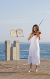 Indian woman play violin Stock Photo